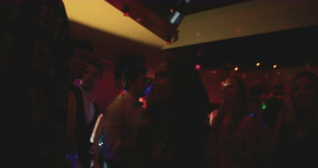 клуб : Silhouettes of party crowd in Night Club with disco lights