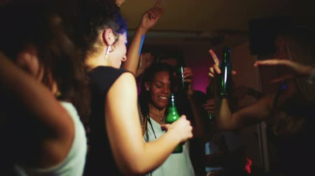 enjoyment : Young African American woman dancing happily with friends in a night club in Slow Motion