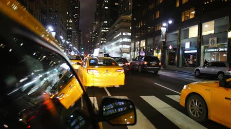 New York City - April 15, 2015 Yellow Cabs taxi driving through Mahattan in New York