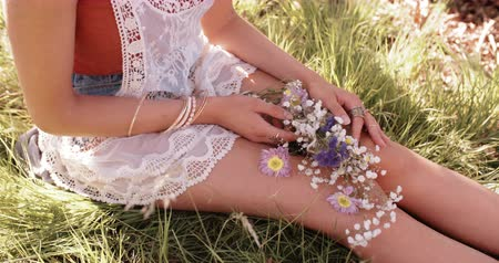 Çingene : Cropped shot of a girls hands holding flowers in lush green grass Stok Video