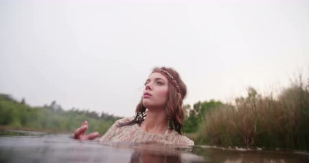 hippi : Beautiful hippie girl wearing vintage white lace, submerged in a natural lake