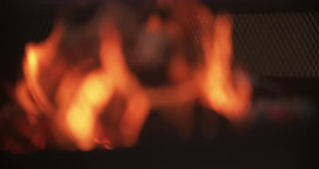 пламя : Fire burning in slow motion, out of focus for background use