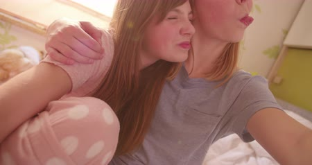 tongue out : Selfie style portrait of two two teen girl friends sticking their tongues out at the camera Stock Footage