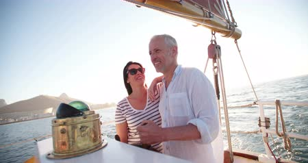 żaglówka : Dreamy vignette shot of senior active couple enjoying the fresh ocean breeze on their leasure cruise on their yacht