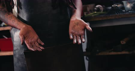 couro : Cropped image of the hands of an afro-american craftsperson showing grease that has collected between the lines on the palms after an honest days work