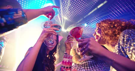 festa : Young attractive Brazilian woman at a nightclub party celebration drinking a cocktail being festive and happy with her multi-ethnic girl friends Stock Footage
