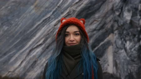 Portrait of a beautiful hipster girl on the background the rocky cliffs. Dyed hair, blue, long. Wideo