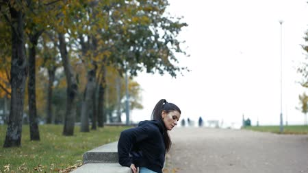aerobic : Portrait of woman in sportswear, doing fitness push-ups exercise at fall park, outdoor.