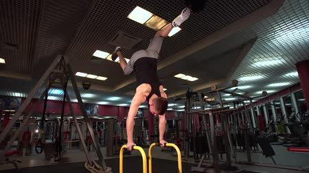 istikrar : Bodyweight exercise, man standing on hands at gym