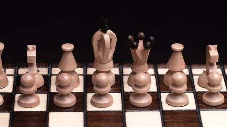 rycerze : chess closeup, wooden chess board, business concept, black background. slide camera. Studio. Wideo