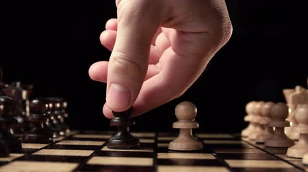 rainha : chess closeup, wooden chess board, business concept, black background. slide camera. Studio. Stock Footage