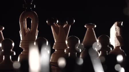 beygir gücü : chess closeup, wooden chess board, business concept, black background. slide camera. Studio. Stok Video