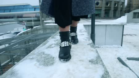 bota : Girl dancing in boots in the snow