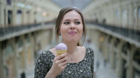 vacations cones : Young woman eat ice cream