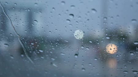 xenon lights : Drops of rain fell on the car on the road. Stock Footage