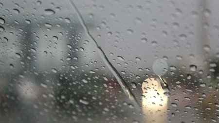 waterdrop : Drops of rain fell on the car on the road. Stock Footage