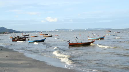 Old Wooden Fishing boats on Sea Coast in Waves