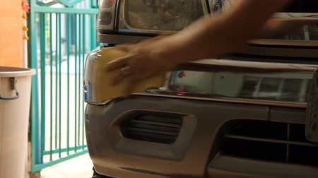 classic car : carwash - closeup on headlight Stock Footage