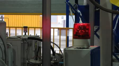 Red light on machine in factory