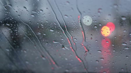 dewy : Drops of rain fell on the car on the road. Stock Footage