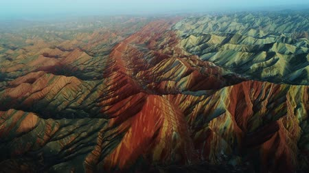 Aerial view on the colorful rainbow mountains of Zhangye danxia landform geological park in Gansu province, China, May 2017. Part 3 of a 3 part series which can be merged into an continuous movie