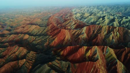 Aerial view on the colorful rainbow mountains of Zhangye danxia landform geological park in Gansu province, China, May 2017. Part 2 of a 3 part series which can be merged into an continuous movie