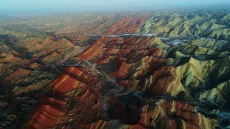 Aerial view on the colorful rainbow mountains of Zhangye danxia landform geological park in Gansu province, China, May 2017. Part 1 of a 3 part series which can be merged into an continuous movie