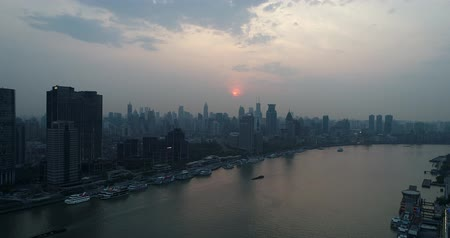 Aerial view of the west bank of the Huangpu River, the Bund and Puxi city center at sunset