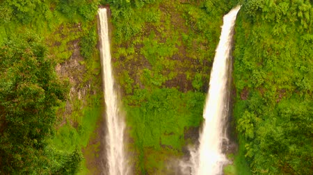 Worlds most amazing waterfalls. Water flowing up an tropical twin waterfall into a plateau covered by tropical jungle.