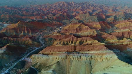Worlds most beautiful landscapes, Rainbow Mountains of Zhangye. One of the most beautiful sections of Zhangye Danxia Rainbow Mountains showing striped pattern on sandstone hills. Part 1 of a 3 part series which can be merged to a continuous movie.