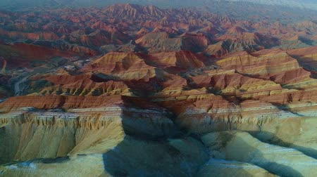 Worlds most beautiful landscapes, Rainbow Mountains of Zhangye. One of the most beautiful sections of Zhangye Danxia Rainbow Mountains showing striped pattern on sandstone hills. Part 2 of a 3 part series which can be merged to a continuous movie.