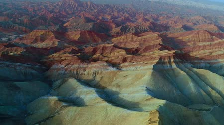 Worlds most beautiful landscapes, Rainbow Mountains of Zhangye. One of the most beautiful sections of Zhangye Danxia Rainbow Mountains showing striped pattern on sandstone hills. Part 3 of a 3 part series which can be merged to a continuous movie.