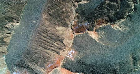 World's most amazing places. Aerial top down view on the colorful rainbow mountains of Zhangye danxia landform geological park in Gansu province. Part 4 of a 9 part series-can be merged to 1 continuous movie Stock mozgókép