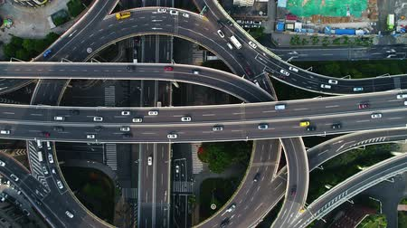 Aerial top down view on busy multilevel interchange overpass in Shanghai showing afternoon traffic coming from the elevated roads Stock mozgókép