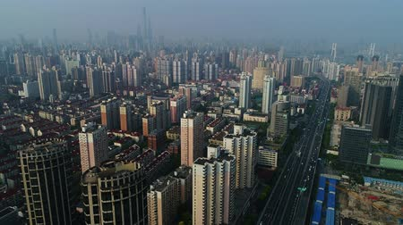 multiple lane : Aerial view on Shanghai with urban residential buildings, elevated road and the financial district in the background Stock Footage