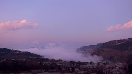 wanderlust : Time lapse of evening landscape with dynamic cloud movement over the Hani Yuanyang rice terraces, world�s most beautiful rice terrace fields.