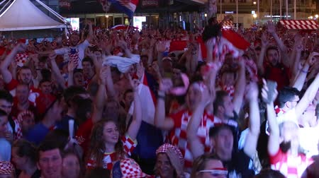 bajnok : ZAGREB, CROATIA - JUNE 16TH, 2018 : Croatian football fans celebrate win of Croatia football team vs Nigeria with the result of 2-0 on Fifa World cup 2018 on Ban Jelacic Square in Zagreb, Croatia.
