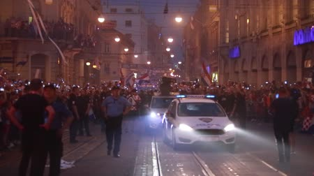 arriving : ZAGREB, CROATIA - JULY 16, 2018 : Croatia National Team welcome home celebration for 2nd place on Fifa World Cup 2018 -  Croatia National Team arriving with the open bus through the Ilica street. Stock Footage