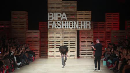 uzunluk : ZAGREB, CROATIA - OCTOBER 24, 2018 : Fashion designer Robert Sever on the runway on the Bipa Fashion.hr fashion show in Zagreb, Croatia.