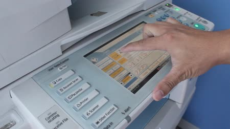 сканер : Printing of computer printer with officer is pressing start button Стоковые видеозаписи