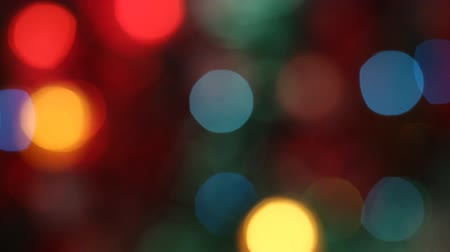 coloured background : Out of focus colorful glimmering lights. Seamless loop.