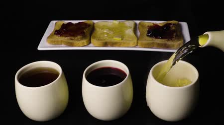 hibiscus tea : Super slow mo three kinds of tea and toast with jam three Stock Footage