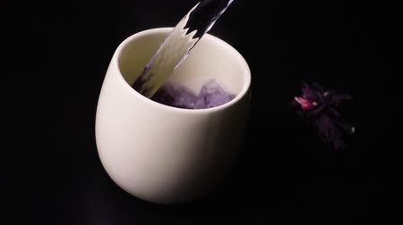 hibiscus tea : Hibiscus tea is brewed up in a ceramic cup slow motion