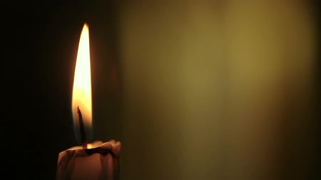 церковь : Candle lights up and being blown out slowly