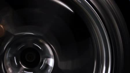 pneus : close up shot of a street car tire speeding Stock Footage