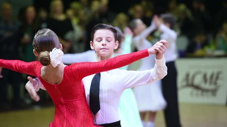 natural world : Kiev, Ukraine -December 06, 2014: kids dancers start to dance at the ballroom dance competition Kyiv open 2014 Stock Footage
