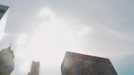 korporacja : Corporate buildings and time lapse view to steel blue glass skyscrapers with clouds passing by, business concept of successful modern architecture with long exposuresclouds. Wideo