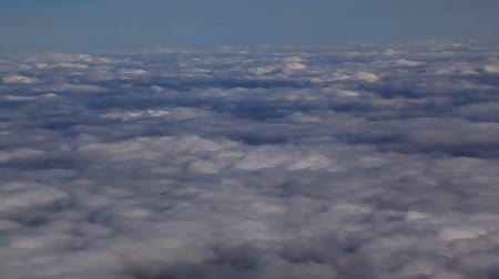 stratosphere : Traveling by air above clouds. View through an airplane window. Flying over the Mediterranean Stock Footage