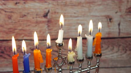 megvilágított : Hanukah candles celebrating the Jewish holiday Stock mozgókép
