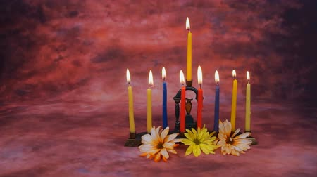 yahudi : Lighting Hanukkah Candles Hanukkah celebration Stok Video
